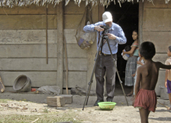 Nicholas Hellmuth photographing in Chisec, Guatemala